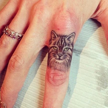 tatuajes de animales en los dedos 2 150x150