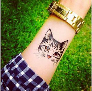 tatuajes de gatos en la muñeca gatitos 3 300x296