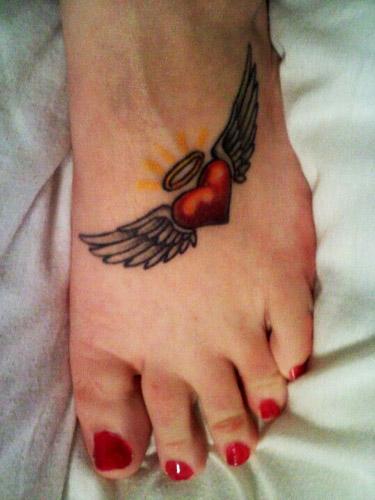 tatuajes corazones alas 6 - tatuajes de corazones