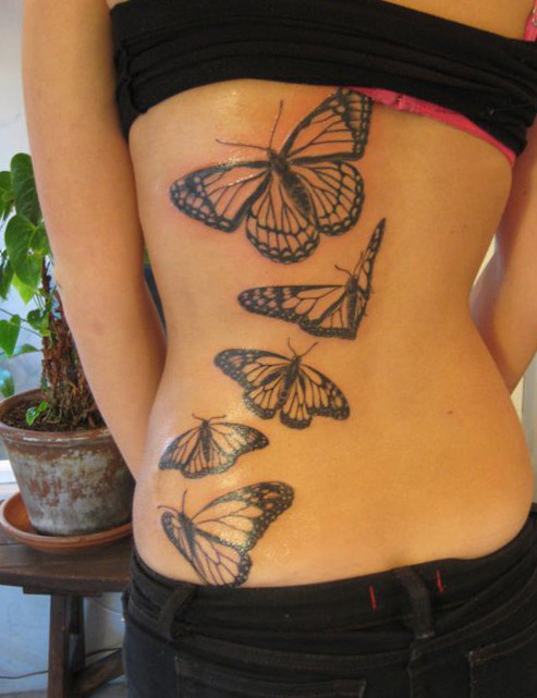 tatuajes mariposas espalda baja caderas pelvis 2 - tatuajes de mariposas