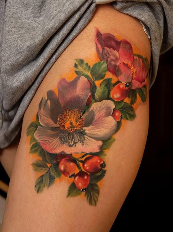 tatuajes de flores en la pierna 5