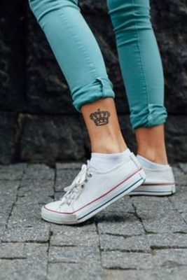 Closeup of teen with a tattoo on her leg