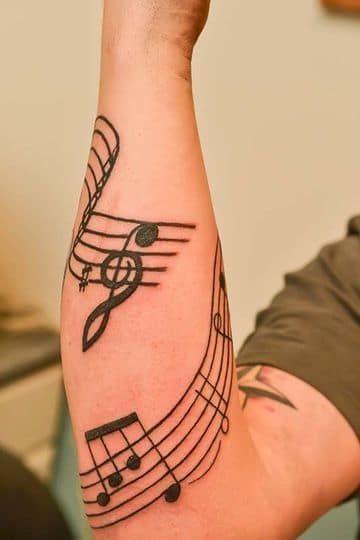 tatuajes notas musicales para hombres 1